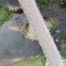 An overhead view of a road bridge crossing a river